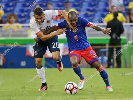 Stock Image of Andres Felipe Roa, Kim Jaggy Colombia's Andres Felipe Roa (20) and Haiti's Kim Jaggy (4) battle for the ball during the second half of a friendly soccer match, in Miami. Colombia defeated Haiti 3-1
