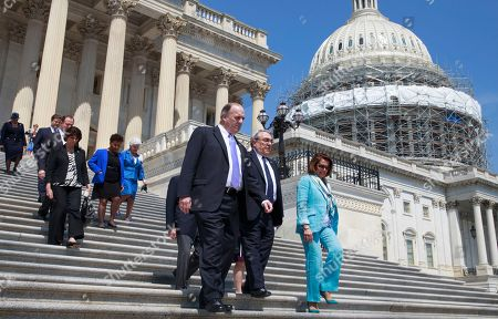 Dan Kildee, G. K. Butterfield, Nancy Pelosi Front row, from left, Rep. Dan Kildee, D-Mich., Rep. G. K. Butterfield, D-N.C., and House Minority Leader Nancy Pelosi of Calif., are followed by Democratic lawmakers as they walk to a news conference on Capitol Hill in Washington, to call on the Republican majority to cancel the upcoming Memorial Day recess to work on unfinished legislation