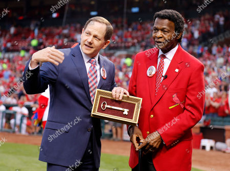 Lou Brock, Francis G. Slay Former St. Louis Cardinals great Lou Brock, right, is given a key to the city by St. Louis mayor Francis G. Slay during a ceremony honoring Brock before the start of a baseball game between the St. Louis Cardinals and the Chicago Cubs, in St. Louis