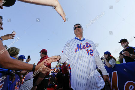 Ron Darling Former New York Mets player Ron Darling greets fans before a baseball game between the Los Angeles Dodgers and the New York Mets, in New York
