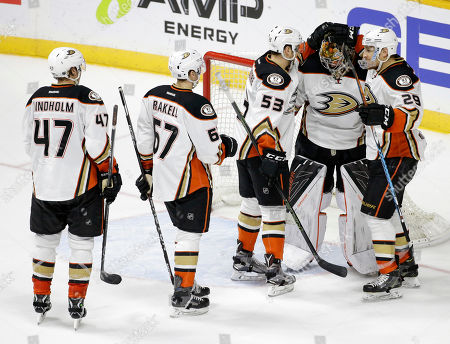 Hampus Lindholm, Rickard Rakell, Shea Theodore, Chris Stewart, Frederik Andersen Anaheim Ducks goalie Frederik Andersen, second from right, of Denmark, is congratulated by Hampus Lindholm (47), of Sweden; Rickard Rakell (67), of Sweden; Shea Theodore (53); and Chris Stewart (29) after the Ducks defeated the Nashville Predators 4-1 in Game 4 in an NHL hockey first-round Stanley Cup playoff series, in Nashville, Tenn. The Ducks evened the series 2-2
