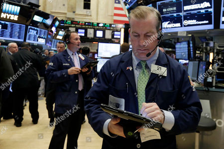 Stock Photo of James Doherty Trader James Doherty, right, works on the floor of the New York Stock Exchange, . Stocks are opening higher on Wall Street as traders were encouraged by talk of more deals and some better news on retail earnings