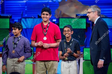 Rishi Nair, Saketh Jonnalagadda, Kapil Nathan, Mo Rocca Rishi Nair of Florida, second from right, stands on stage with second place winner Saketh Jonnalagadda of Massachusetts, center, and third place winner Kapil Nathan of Alabama, left, after winning the 2016 National Geographic Bee, at the National Geographic Society in Washington. At right is host Mo Rocca