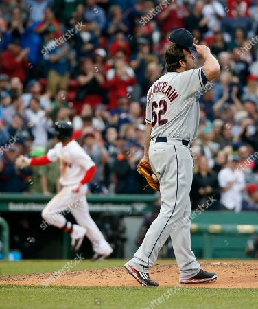 Joba Chamberlain, Mookie Betts Cleveland Indians' Joba Chamberlain walks back to the mound after giving up a grand slam to Boston Red Sox's Mookie Betts, right, during the seventh inning of a baseball game in Boston