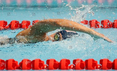 Elizabeth Marks heads to a gold medal victory in the women's 100 meter LC freestyle ISB race during the swimming events at the Invictus Games, in Kissimmee, Fla