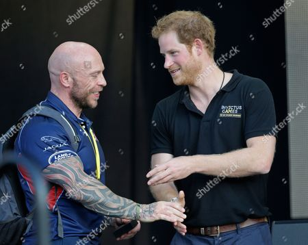Prince Harry Britain's Prince Harry, right, greets athlete Michael Yule, of the United Kingdom during the closing ceremony at the Invictus Games, in Kissimmee, Fla
