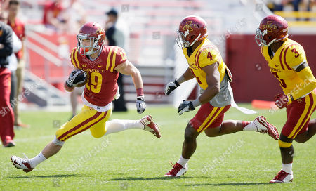 Trever Ryen, Troy Vincent, Mike Johnson Iowa State wide receiver Trever Ryen, left, runs from defenders Troy Vincent (4) and Mike Johnson, right, after making a reception during the team's NCAA college football spring game, in Ames, Iowa
