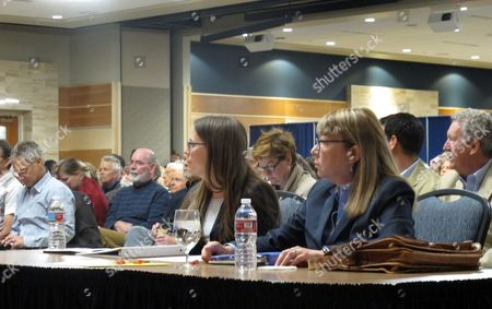 "Viv Hammill, right, and Jessica Brubaker, to her left, attorneys for Montana's commissioner of higher education, listen to introductory remarks ahead of oral arguments before the Montana Supreme Court, in Bozeman, Mont. The commissioner's office is appealing a judge's order to release documents about a rape case to ""Into the Wild"" author Jon Krakauer"
