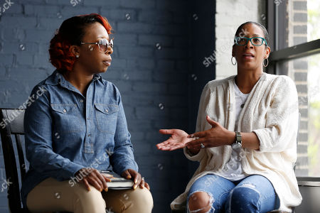 Lezley McSpadden In this photo made, Lezley McSpadden and co-author Lyah Beth LeFlore speak during an interview in St. Louis. McSpadden was sitting in her car on a smoke break from her grocery store job on Aug. 9, 2014, when a friend told her someone had been shot near Canfield Apartments in Ferguson, Mo. After that her life crumbled learning her son, 18-year-old son Michael Brown, had been shot and killed by a police officer