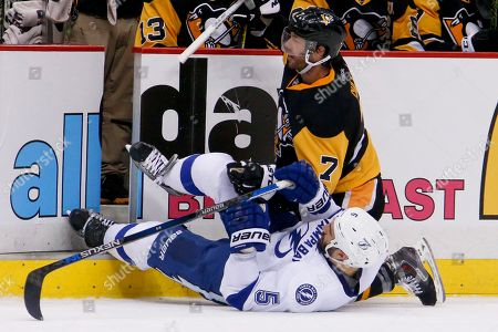 Matt Cullen, Jason Garrison Pittsburgh Penguins' Matt Cullen (7) and Tampa Bay Lightning's Jason Garrison (5) hit the ice along the boards during the second period of Game 5 of the NHL hockey Stanley Cup Eastern Conference finals, in Pittsburgh