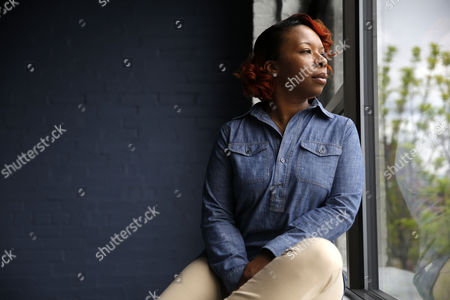 "Lezley McSpadden In this April 27, 2016, photo, Lezley McSpadden poses for a portrait in St. Louis. McSpadden was sitting in her car on a smoke break from her grocery store job on Aug. 9, 2014, when a friend told her someone had been shot near Canfield Apartments in Ferguson, Mo. After that her life crumbled learning her son, 18-year-old son Michael Brown, had been shot and killed by a police officer. McSpadden recounts what happened that fateful day two summers ago in her autobiography, ""Tell the Truth & Shame the Devil,"" set to be released, and co-written by Lyah Beth LeFlore"