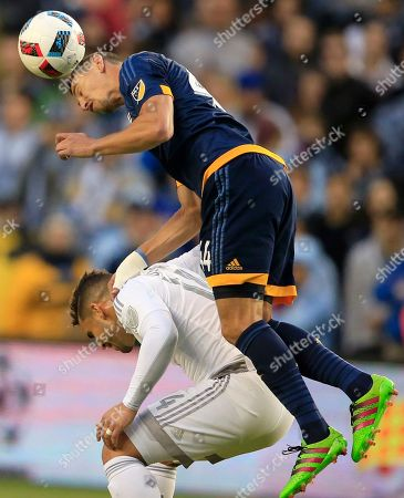 Daniel Steres, Dom Dwyer Los Angeles Galaxy defender Daniel Steres (44) heads the ball over Sporting Kansas City forward Dom Dwyer (14) during the first half of an MLS soccer match in Kansas City, Kan