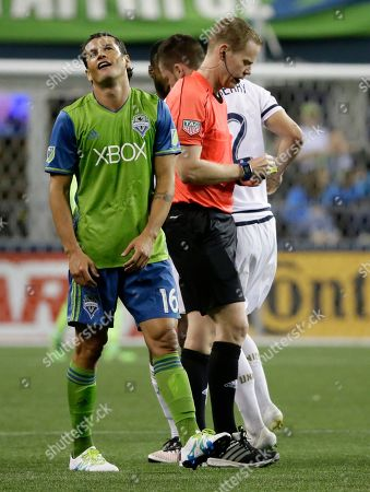 Nelson Valdez Seattle Sounders' Nelson Valdez, left, reacts after being given a yellow card by head referee Drew Rischer, right, in the second half of an MLS soccer match against the Philadelphia Union, in Seattle