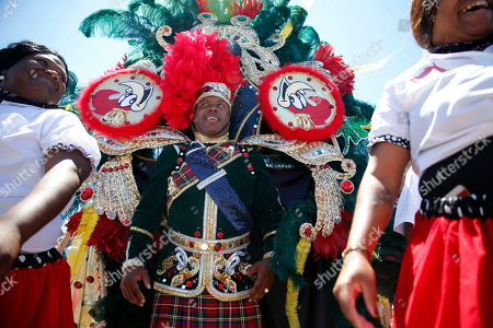 King Woody of the King Woody Social Aid & Pleasure Club walks in a symbolic jazz funeral for New Orleans music icon Allen Toussaint at the New Orleans Jazz and Heritage Festival in New Orleans