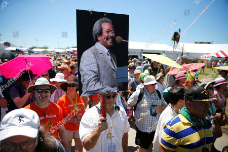 Marchers participate in a symbolic jazz funeral for New Orleans music icon Allen Toussaint, at the New Orleans Jazz and Heritage Festival in New Orleans
