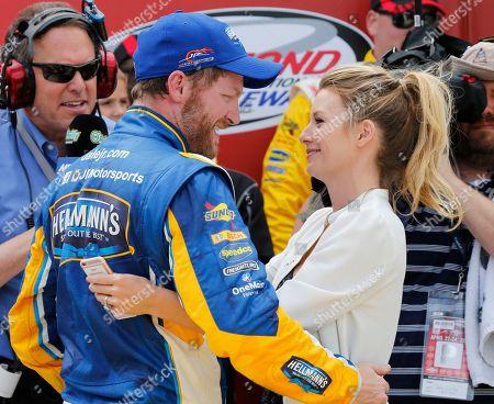 Dale Earnhardt Jr., Amy Reimann Dale Earnhardt Jr.,left, gets a hug from his fiancee Amy Reimann as he celebrates winning the Xfinity series auto race at Richmond International Raceway in Richmond, Va
