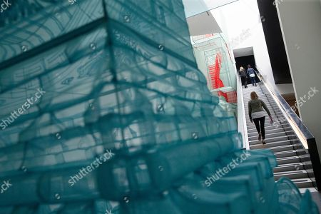 "Visitors browse an exhibit of work by Korean-American artist Do Ho Suh at the Contemporary Arts Center, in downtown Cincinnati. The exhibit,""Passage,"" is inspired by the various homes and locals the artist has lived"