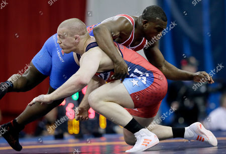 Jeke Varner, Kyven Gadson Jake Varner tries to take down Kyven Gadson, right, during their 97-kilogram freestyle match at the U.S. Olympic Wrestling Team Trials, in Iowa City, Iowa