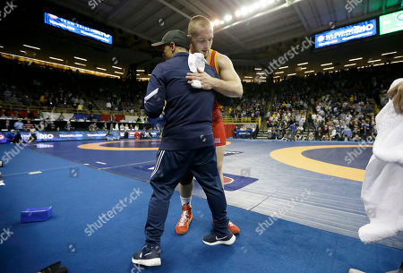 Stock Photo of Kyle Snyder Kyle Snyder, right, gets a hug after beating Jake Varner in their 97-kilogram freestyle final match at the U.S. Olympic Wrestling Team Trials, in Iowa City, Iowa