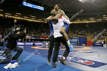 Jordan Burroughs Jordan Burroughs celebrates with his coaches after beating Andrew Howe in their 75-kilogram freestyle finals match at the U.S. Olympic Wrestling Team Trials, in Iowa City, Iowa