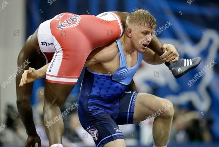 Stock Image of Kyle Dake, Richard Perry Kyle Dake, right, takes Richard Perry to the mat during their 86-kilogram freestyle match at the U.S. Olympic Wrestling Team Trials, in Iowa City, Iowa
