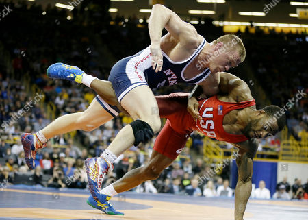 Andrew Howe, left, tries to take Jordan Burroughs to the mat during their 74-kilogram freestyle match at the U.S. Olympic Wrestling Team Trials, in Iowa City, Iowa