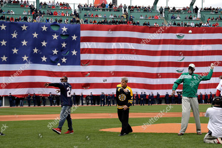 Ty Law, Bobby Orr, Bill Russell From left, former New England Patriots Ty Law, Boston Bruins legend Bobby Orr and Boston Celtics great Bill Russell deliver ceremonial first pitches before the home opener baseball game between the Boston Red Sox and the Baltimore Orioles at Fenway Park, in Boston