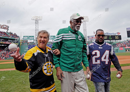 Bobby Orr, Bill Russell, Ty Law Boston Bruins legend Bobby Orr tosses a ball to a fan as he, Boston Celtics great Bill Russell and New England Patriots Ty Law (24) leave the field after delivering ceremonial first pitches before the home opener baseball game between the Boston Red Sox and the Baltimore Orioles at Fenway Park, in Boston