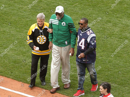 Bobby Orr, Bill Russell, Ty Law Boston Bruins legend Bobby Orr, left, Boston Celtics great Bill Russell, center, and New England Patriots' Ty Law, right, step off the field after delivering ceremonial first pitches before the home opener baseball game between the Boston Red Sox and the Baltimore Orioles at Fenway Park, in Boston