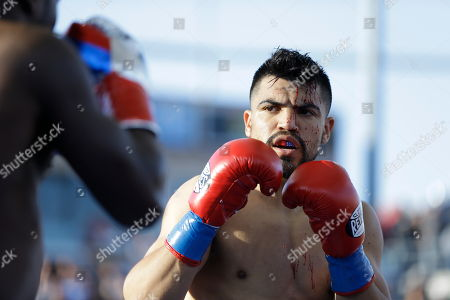 Andre Berto, Victor Ortiz Victor Ortiz bleeds during a welterweight boxing match with Andre Berto, in Carson, Calif