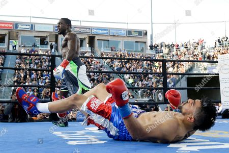 Andre Berto, Victor Ortiz Andre Berto walks to his corner after knocking down Victor Ortiz, foreground, during the fourth round of a welterweight boxing match, in Carson, Calif. Berto won by knockout in the fourth round