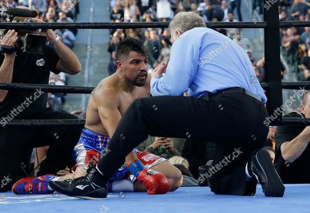 Jack Reiss, Victor Ortiz Referee Jack Reiss, right, counts after Victor Ortiz was knocked down by Andre Berto during the fourth round of a welterweight boxing match, in Carson, Calif. Berto won by knockout in the fourth round
