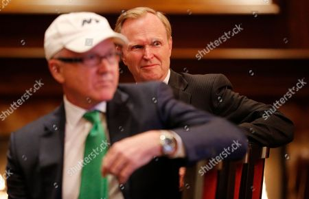 Woody Johnson, John Mara New York Giants owner John Mara, background, sits next to New York Jets owner Woody Johnson, front, while they watch a video presentation announcing a concert by Paul McCartney at MetLife Stadium, in East Rutherford, N.J. The concert is scheduled for Aug. 7