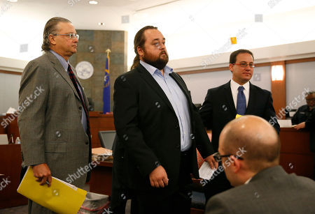 "Austin Lee Russell, center, better known as Chumlee from the TV series ""Pawn Stars,"" appears in court with attorneys David Chesnoff, left, and Richard Schonfeld, in Las Vegas. Russell and his lawyers told a Las Vegas judge he intends to plead guilty in state court to felony weapon and misdemeanor attempted drug possession charges"