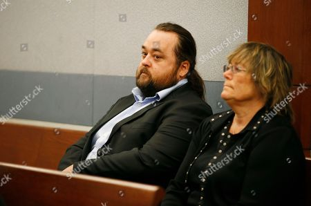 "Austin Lee Russell, left, known better as Chumlee from the TV series ""Pawn Stars,"" appears in court, in Las Vegas. Russell and his lawyers told a Las Vegas judge on Monday he intends to plead guilty in state court to felony weapon and misdemeanor attempted drug possession charges"