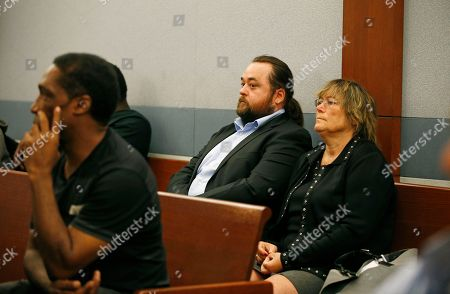 "Stock Picture of Austin Lee Russell, center, better known as Chumlee from the TV series ""Pawn Stars,"" appears in court, in Las Vegas. Russell and his lawyers told a Las Vegas judge he intends to plead guilty in state court to felony weapon and misdemeanor attempted drug possession charges"