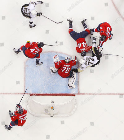 Braden Holtby, Patric Hornqvist, John Carlson, Tom Wilson, Brooks Orpik, Mike Richards, Kris Letang Washington Capitals goalie Braden Holtby (70) stops a shot by Pittsburgh Penguins right wing Patric Hornqvist (72) during the second period of Game 2 in an NHL hockey Stanley Cup Eastern Conference semifinals in Washington. Also on the ice are Washington Capitals defenseman John Carlson (74), right wing Tom Wilson (43), defenseman Brooks Orpik (44) center Mike Richards (10) and Pittsburgh Penguins defenseman Kris Letang (58). Pittsburgh went on to win 2-1
