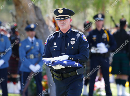 Joseph Yahner Phoenix Police Chief Joseph Yahner carries the burial flag of Phoenix Police Officer David Glasser to family members, in Phoenix. Officer Glasser died May 19 a day after he was shot while responding to a call about a son stealing guns from his father. Glasser, a 12-year veteran, is survived by a wife and two children