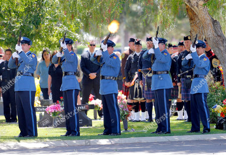 A 21-gun salute is fired during the funeral for Phoenix Police Officer David Glasser, in Phoenix. Officer Glasser died May 19, a day after he was shot while responding to a call about a son stealing guns from his father. Glasser, a 12-year veteran, is survived by a wife and two children