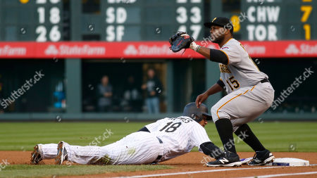 Stock Image of Cristhian Adames, Jason Rogers Colorado Rockies' Cristhian Adames, left, dives back into first base as Pittsburgh Pirates first baseman Jason Rogers fields the pickoff throw from starting pitcher Gerrit Cole in the first inning of a baseball game, in Denver