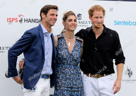 Prince Harry, Delfina Blaquier, Malcolm Borwick Britain's Prince Harry, from right, Delfina Blaquier and Malcolm Borwick pose for photographers upon their arrival at Valiente Polo Farm, in Wellington, Fla. Prince Harry participated in a Sentebale polo charity match which specializes in helping children that have been affected by the AIDS and HIV epidemic