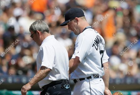 Jordan Zimmermann, Kevin Rand Detroit Tigers starting pitcher Jordan Zimmermann walks off the field with trainer Kevin Rand during the sixth inning of a baseball game against the Tampa Bay Rays, in Detroit