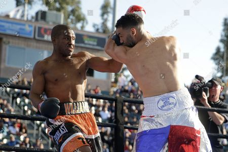 Edwin Rodriguez, Thomas Williams Jr Edwin Rodriguez, right, takes a punch from Thomas Williams Jr. during the first round of a light heavyweight boxing match, in Carson, Calif. Williams won by knockout in the second round