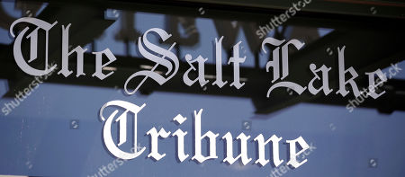 The Salt Lake Tribune sign is shown, in Salt Lake City. A son of wealthy industrialist Jon Huntsman Sr. has agreed to buy The Salt Lake Tribune, ending uncertainty about the future of Utah's largest independent newspaper. Digital First Media announced in a news release Wednesday that the company reached an agreement to sell the newspaper to Paul Huntsman. Terms of the deal weren't disclosed