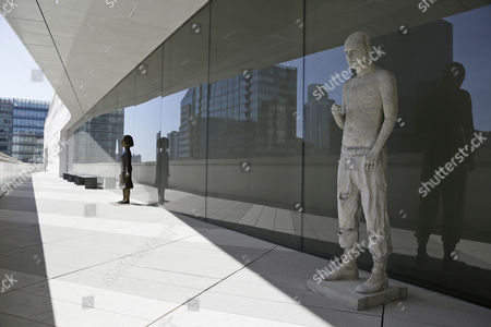 Sculptures by Marc Quinn and Kiki Smith are seen on a terrace during a preview of the newly expanded San Francisco Museum of Modern Art, in San Francisco. Designed in partnership with architecture firm Snøhetta, the expansion will more than double the museum's exhibition space. The museum opens on May 14