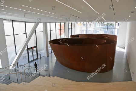 A half-million pound free-standing sculpture by Richard Serra called Sequence is seen during a preview of the newly expanded San Francisco Museum of Modern Art, in San Francisco. Designed in partnership with architecture firm Snøhetta, the expansion will more than double the museum's exhibition space. The museum opens on May 14
