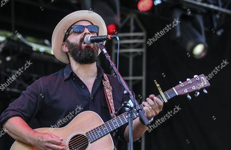 Stock Picture of Drew Holcomb and The Neighbors perform at the Shaky Knees music festival, in Atlanta. The three-day event was being held in Centennial Olympic Park