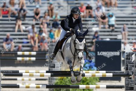 Stock Image of Hannah Selleck Hannah Selleck, daughter of actor Tom Selleck, competes at the Global Champions Tour show jumping competition, in Miami Beach, Fla. Miami Beach is the first leg of a 15-city tour for this competition, which is a warmup for the Summer Olympics in Rio de Janeiro