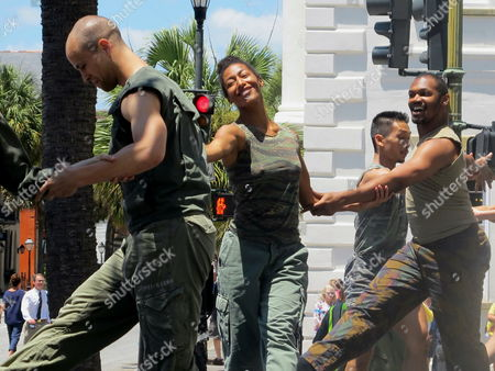 Members of the Bill T. Jones/Arnie Zane Company dance during the opening ceremonies of the 40th Spoleto Festival USA in front of city hall in Charleston, S.C., on . The internationally known arts festival runs through June 12, 2016