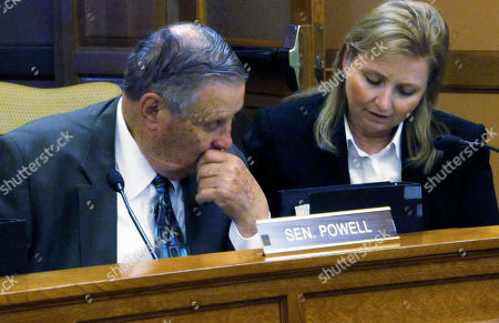 Kansas state Sen. Larry Powell, left, R-Kalvesta, and Sen. Caryn Tyson, right, R-Parker, confer during a Senate Ways and Means Committee on budget proposals, at the Statehouse in Topeka, Kan. The committee and its House counterpart have approved proposals from Gov. Sam Brownback to provide an additional $17 million to the state's two mental hospitals